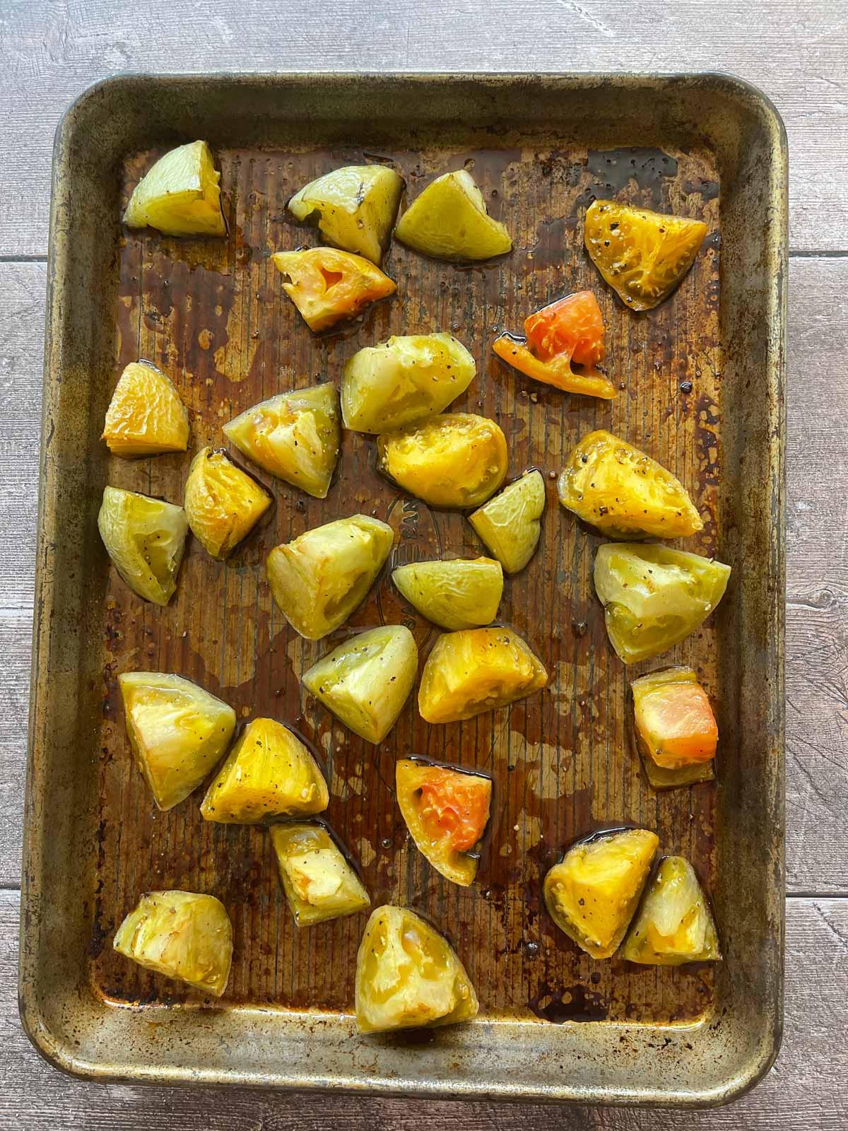Roasted green tomatoes on baking sheet