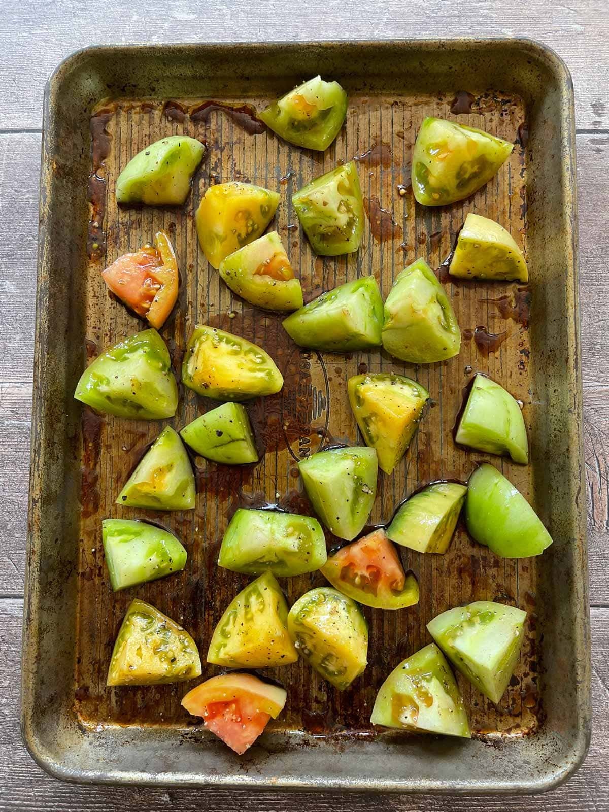 Uncooked green tomatoes on baking sheet